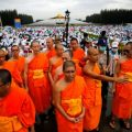 Buddhist monks and followers gather inside the Wat Phra Dhammakaya temple complex in anticipation of a planned police raid, in Pathum Thani province, north of Bangkok, Thailand, June 16, 2016. REUTERS/Athit Perawongmetha