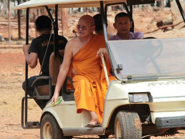 "Phra Wisutthi Sarathera, the abbot of Thailand's ""Tiger Temple,"" rides in a golf cart Thursday at a news conference addressing allegations of illegal tiger trading."
