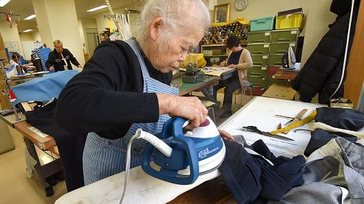 Workers repair clothes at a seniors' work center in Tokyo. Japan's rapidly aging population