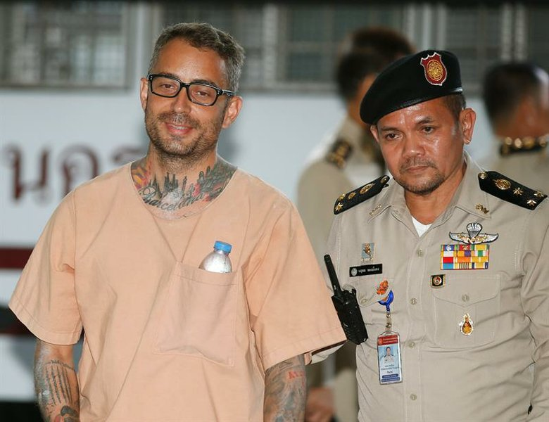 Spanish national from Barcelona, Artur Segarra Princep (L) is escorted by prison personnel