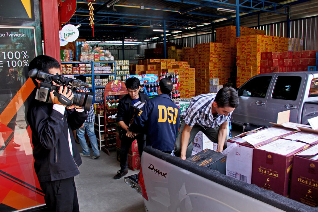 Department of Special Investigation officials seize authentic liquor and fake liquor at warehouse in Bangkok