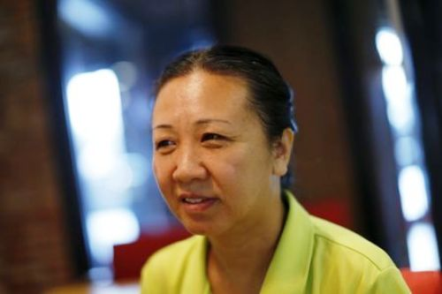 Chinese dissident Liu Xuehong speaks during an interview with Reuters in Bangkok
