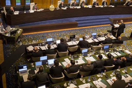 A tribunal of five arbitrators (seated top right) hears the case regarding the Philippines and China on the South China Sea at the Permanent Court of Arbitration (PCA) at The Hague, the Netherlands