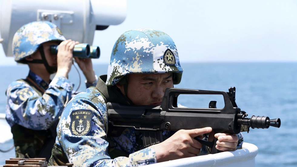 A Chinese soldier takes aim during a military drill in the South China Sea
