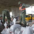 Soldiers distribute sand bags to residents in Ilan county, north-east Taiwan.