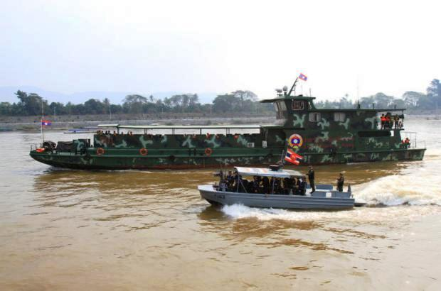Thai and Lao patrol boats ply the Mekong River in Chiang Saen district of Chiang Rai, in a joint operation to thwart drug trafficking.