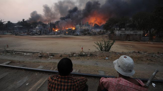 A mob wielding weapons razed a Muslim prayer hall in northern Myanmar, state media reported Saturday