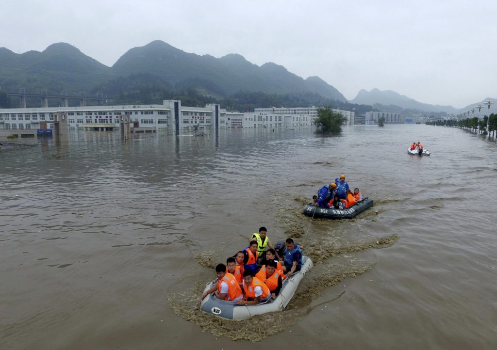 Rescuers evacuate residents trapped by flood waters in Zhijin county, southwest China's Guizhou province