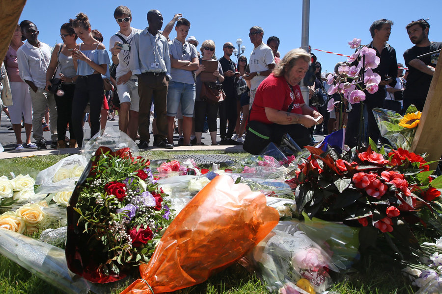 Flowers are laid out near the site of the truck attack in Nice. The attack ended when police shot and killed the driver.