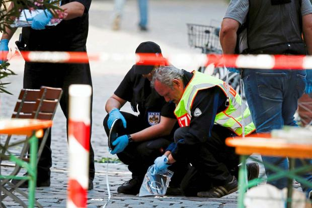 Police examining the scene of the attack at the Ansbach festival