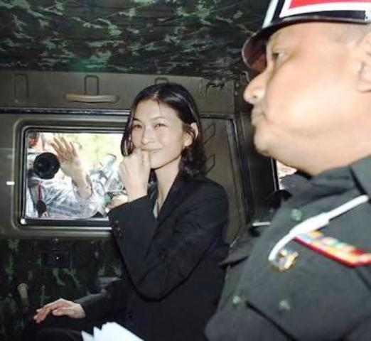 Tassanee Buranupakorn is arrested by military authorities accused of sedition and detained without lawyer access.
