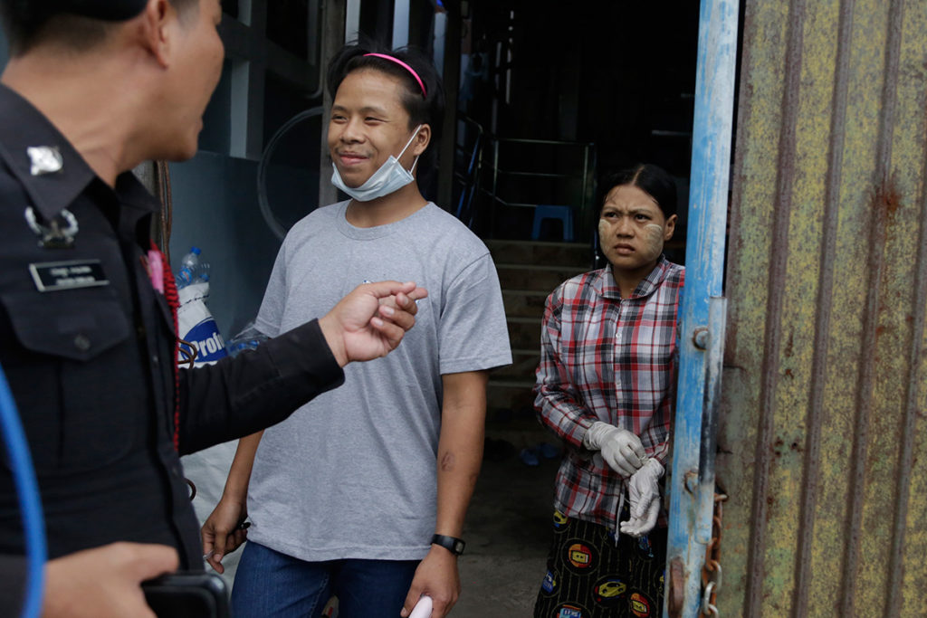 Burmese worker Tin Nyo Win smiles after he was reunited with his wife, Mi San, during a raid of a shrimp-peeling shed in Samut Sakhon on Nov. 9, 2015.