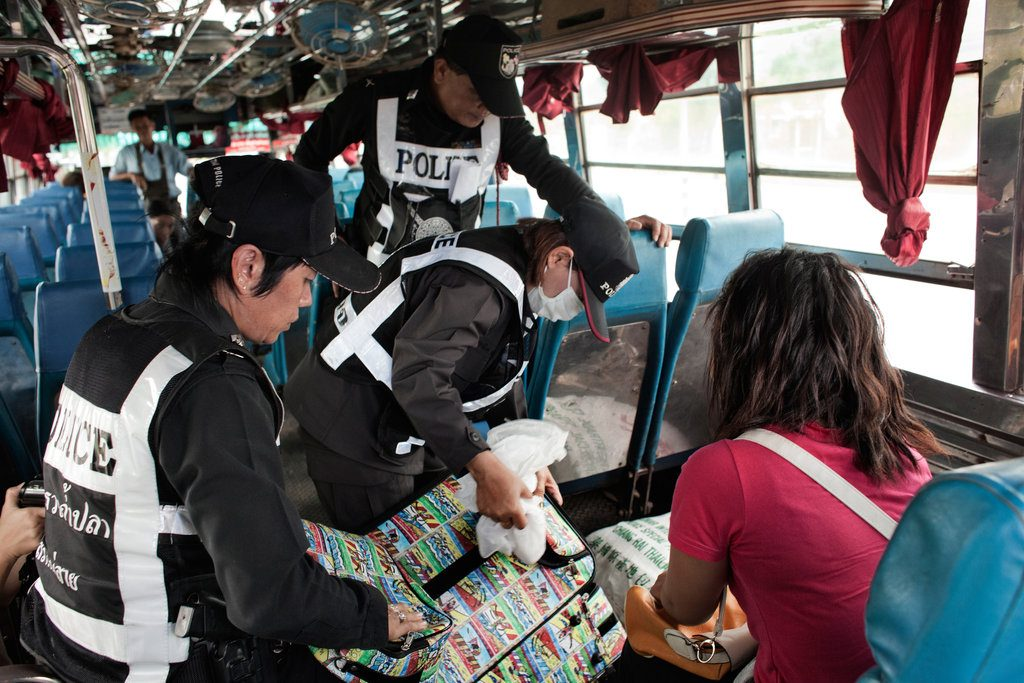 Police search bus at a checkpoint on the way to Mae Sai, Chiang Rai