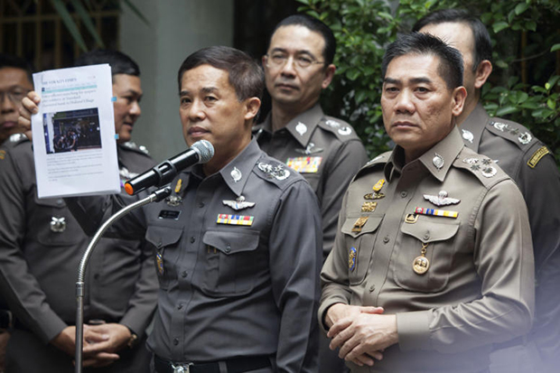 Pol Gen Chakthip Chaijinda (right) talks to reporters at the briefing in Bangkok on Wednesday morning. (Photo by Pawat Laopaisarntaksin)