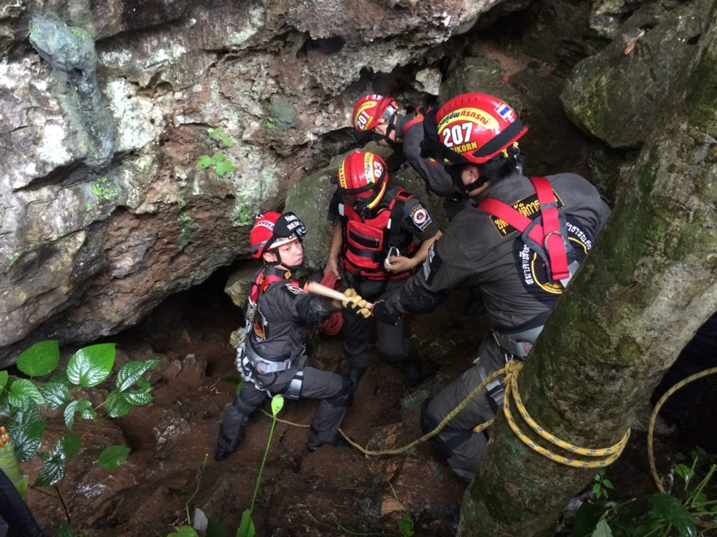 Search parties on Sunday inspect one of many caves in the Tham Luang - Khun Nam Nang Non forest park - Photo Teeranai Charuvastra