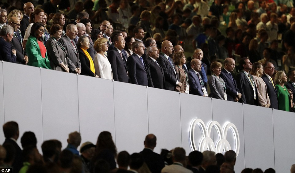 IOC President Thomas Bach, front row ninth left, and other dignitaries stand during the opening ceremony for the 2016 Summer Olympics