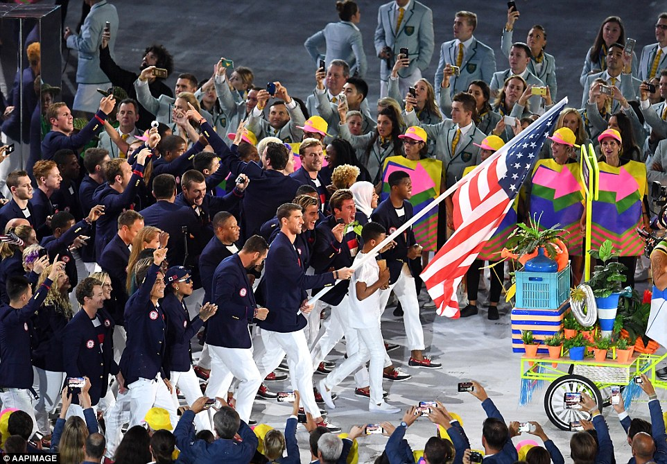 Flagbearer Michael Phelps (USA) of United States of America leads his contingent during the opening ceremony