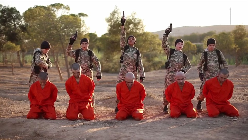 The British boy (second from the right) is identified as Abu Abdullah al-Britani Read more: http://www.dailymail.co.uk/news/article-3760598/Terrifying-new-ISIS-video-shows-British-boy-executing-prisoners-Syria.html#ixzz4IZmzqZpt Follow us: @MailOnline on Twitter   DailyMail on Facebook