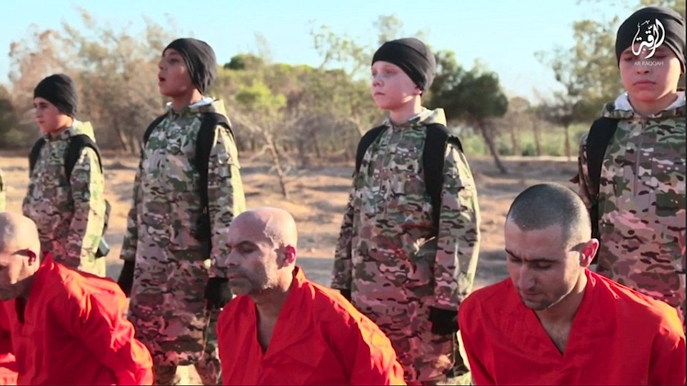 The British boy (second from right, in camouflage) shows all the signs of being brainwashed.