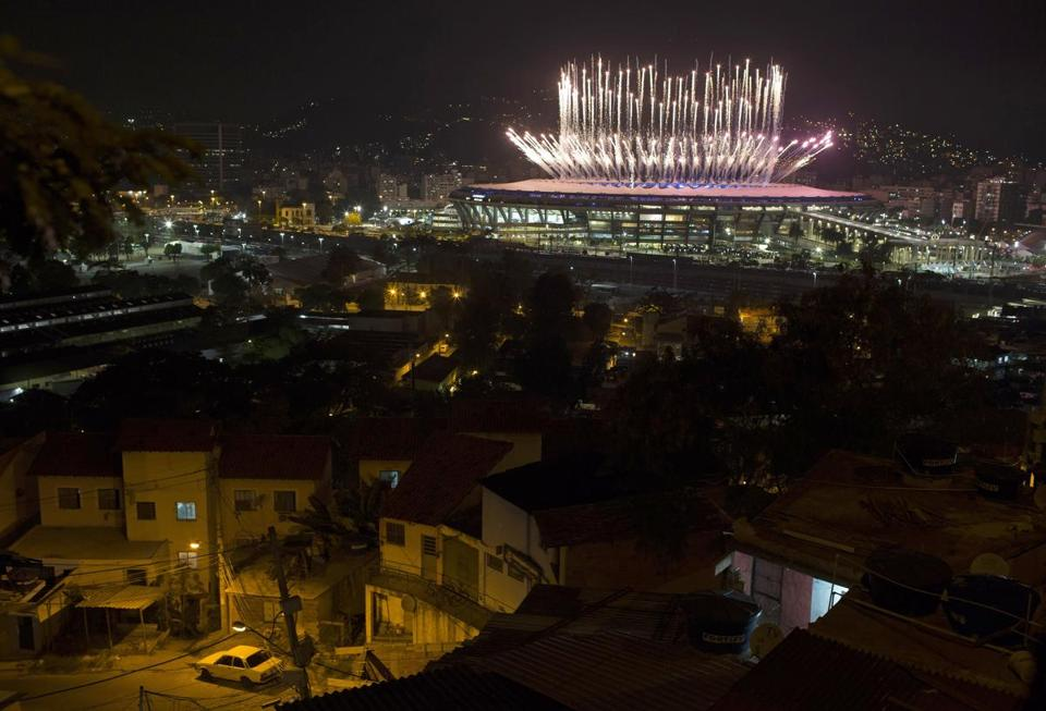 The Mangueira slum was backdropped by fireworks exploding above the Maracana stadium during the opening ceremony of the Rio's 2016 Summer Olympics.