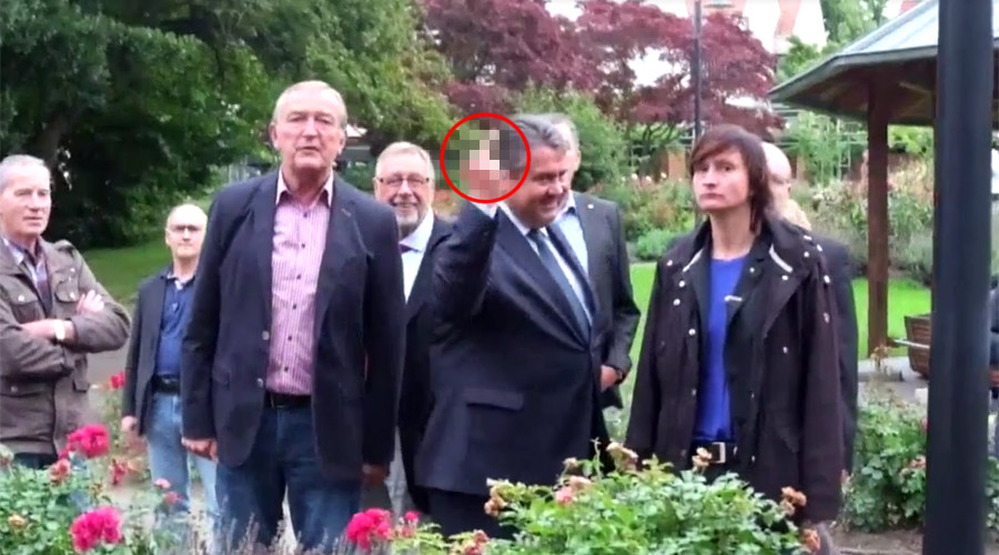 Vice Chancellor Sigmar Gabriel flipping the bird at a group of neo-Nazis in the central German town of Salzgitter on Friday.
