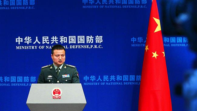 Chinese Defense Ministry spokesman Colonel Yang Yujun talks to media about South China Sea