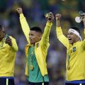 Brazil's Neymar, right, and Gabriel Jesus, center, celebrate after receiving their gold medals
