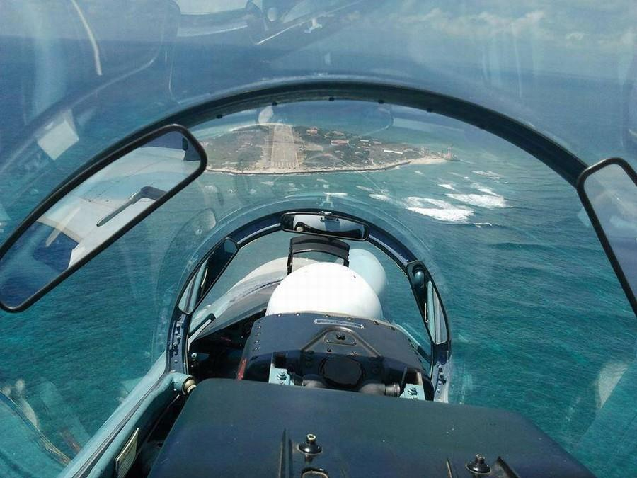 Su-30 fighters fly over Nanwei Island in South China Sea