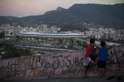 Two boys look out from the Mangueira slum towards the Maracana Stadium in Rio