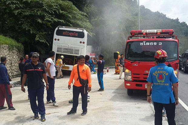 Rescue workers retrieve three injured Chinese tourists from a white tour bus which crashed into a barrier while going down the Patong hill in Kathu district of Phuket on Friday morning. (Photo Achadtaya Chuenniran)