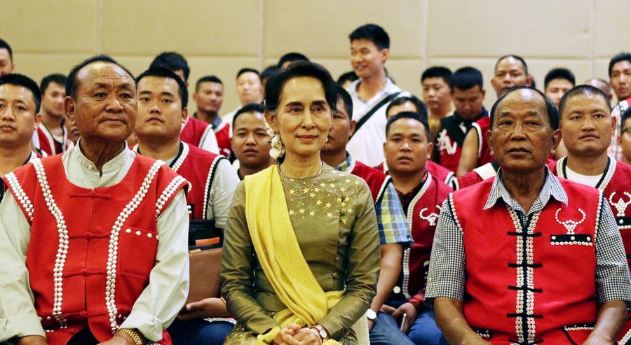 Myanmar's Foreign Minister Aung San Suu Kyi, center, sits with members of the United Wa State Army (UWSA) as they pose for photographs following a meeting of armed ethnic groups in Naypyitaw, Myanmar.