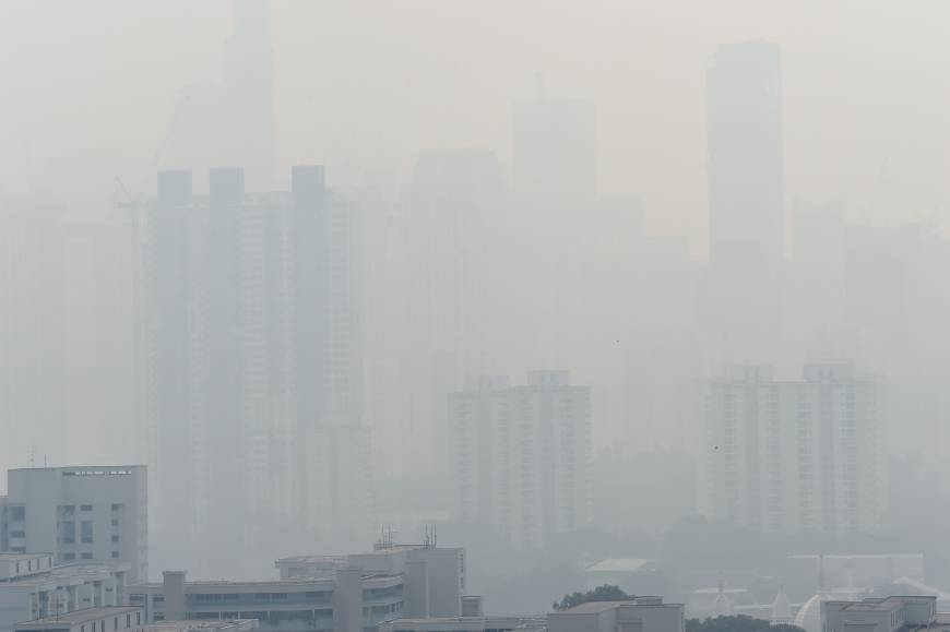 The Singapore skyline is hardly visible Friday due to haze. Smog and a strong acrid smell blanketed Singapore as smoke from forest fires in Indonesia blew into the city-state. | AFP-JIJI