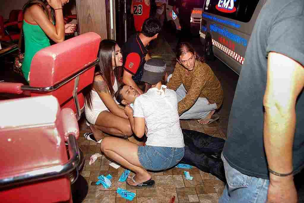 People help an injured man after twin bombs exploded in the upscale resort of Hua Hin, Thailand, on Thursday. AFP