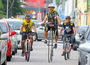 Cycling for a good cause: Pastor Cheah (centre) riding the penny-farthing with representatives from the 'Bike on Friday' group in Penang. He started his journey from Chiang Rai on Aug 2.