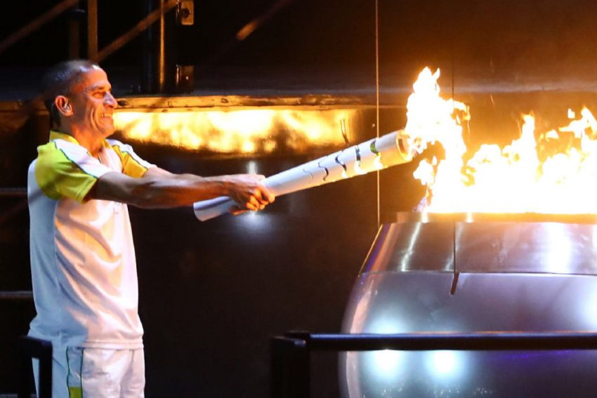 Former athlete Vanderlei de Lima lights the Olympic Flame during the opening ceremony of the Rio