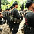 Members of the New Peoples Army (NPA) belonging to the Pulang Bagani Command celebrate the 40th Founding Anniversary of the Communist Party of the Philippines