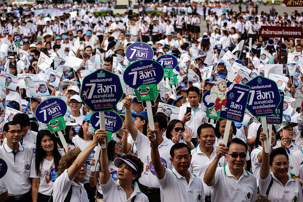 Civil servants and military school students at a Bangkok rally supporting passage of the Aug. 7 referendum on the country's constitution