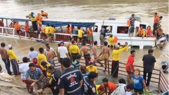 Rescue boats and fire-fighting vessels were rushed to the scene to pluck passengers from the sinking boat.