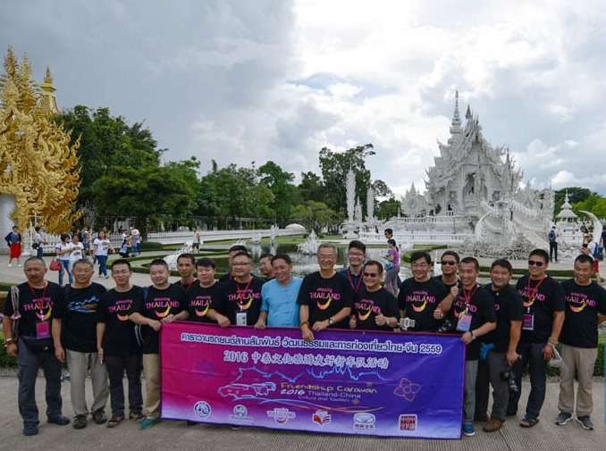 Members of the Sino-Thai Culture and Tourism Friendship Caravan pose for group photos at White Temple in Phan, Chiang Rai.