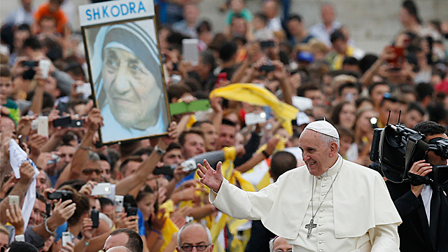 Catholic's and gatherers celebrate after Mother Teresa proclaimed a saint by Pope Francis.