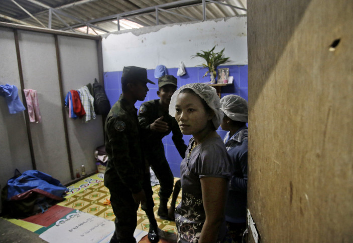 Thai soldiers search a room at the workers' living quarters during a raid on a shrimp shed in Samut Sakhon, Thailand. (AP Photo/Dita Alangkara)