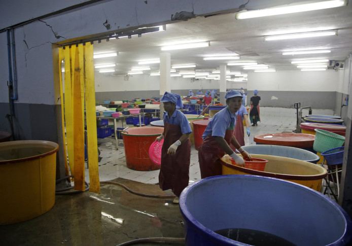 AP recently visited a handful of Samut Sakhon shrimp sheds - some now rebranded as shrimp factories (AP Photo/Dita Alangkara)