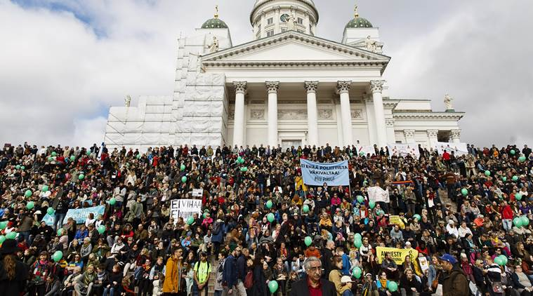 People demonstrate against racism and fascism in Helsinki, Finland Saturday, Sept. 24, 2016, after a man, who took exception to a neo-Nazi demonstration in central Helsinki on September 10th, died a week after he was assaulted at the demonstration. (Roni Rekomaa/Lehtikuva via AP)