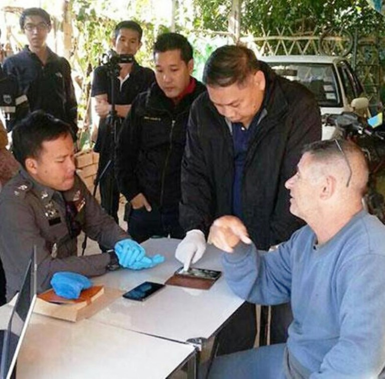 Fabian Frederick Blandford, 64, a British national, is interrogated by officers from the Department of Special Investigation during a search of his house in Fang district of Chiang Mai