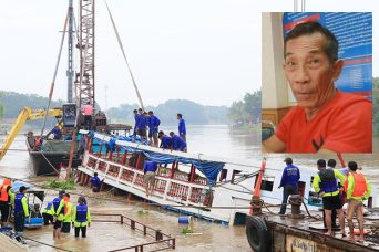 Pilot charged while Salvage crews raise the sunken tour boat from the Chao Phraya river.