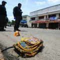 A school bag lies on a street next to the site of a bomb attack at Tak Bai district in the troubled southern province of Narathiwat, Thailand, September 6, 2016. REUTERS/Surapan Boonthanom