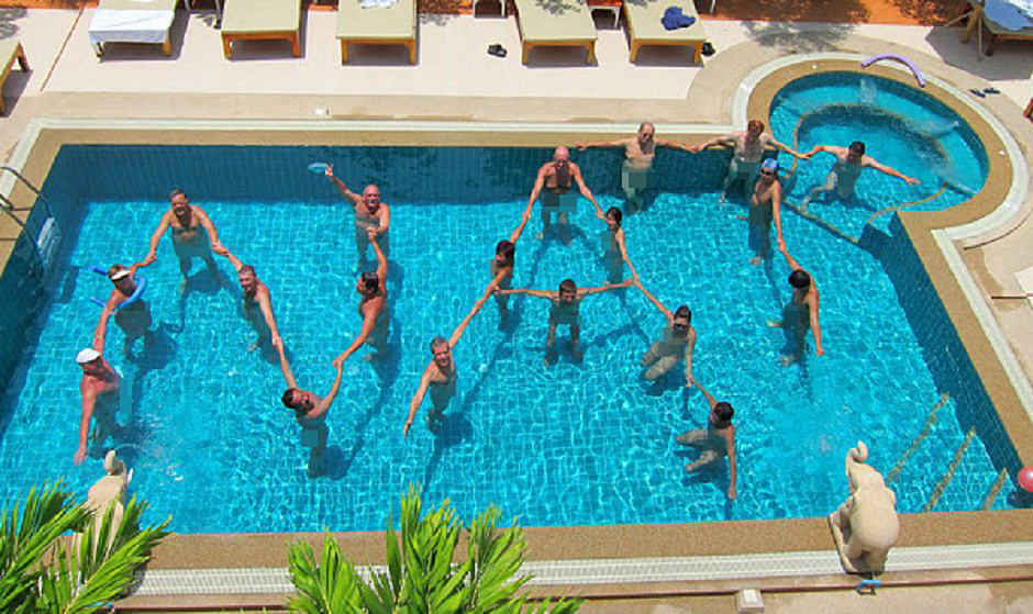 Members of the Naturist Association Thailand (NAT) posing for a picture