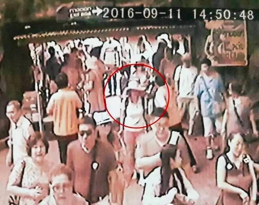 She was wearing a white T-shirt, red shorts and a white wide-brimmed hat.