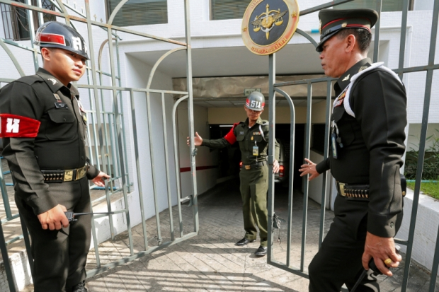 Military police officers guarding the gates of the military court in Bangkok, Thailand