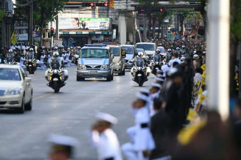 a royal convoy led by a van carrying Bhumibol's body and monks drove to the Grand Palace complex from Siriraj hospital, where the king died Thursday at age 88